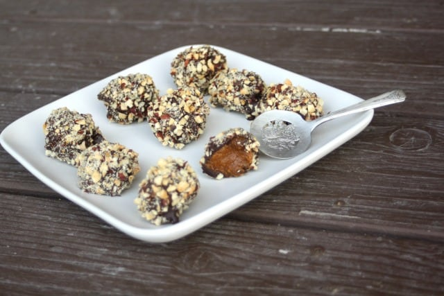 A no-bake treat full of fall flavor these dark chocolate and hazelnut pumpkin pie truffles are a delicious dessert that comes together easily.