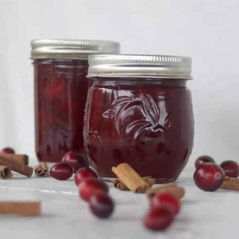 Brandied cranberry sauce in jars.