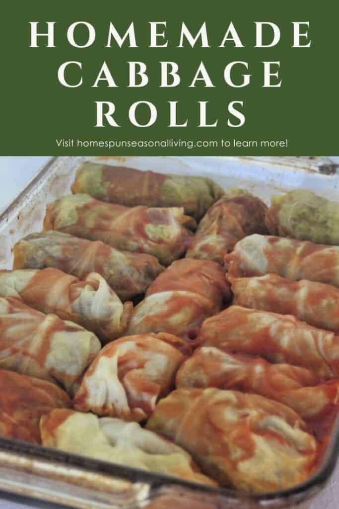 A glass baking tray full of cooked cabbage rolls covered in tomato juice with text overlay reading: homemade cabbage rolls.