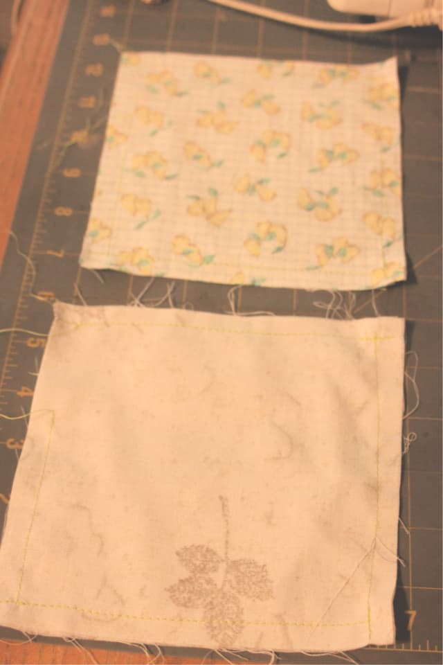 Two pillow case squares sewn together on a table.