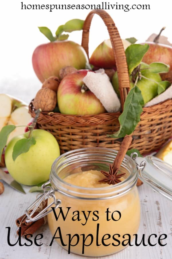 Applesauce in a jar with fresh apples in a basket with spices
