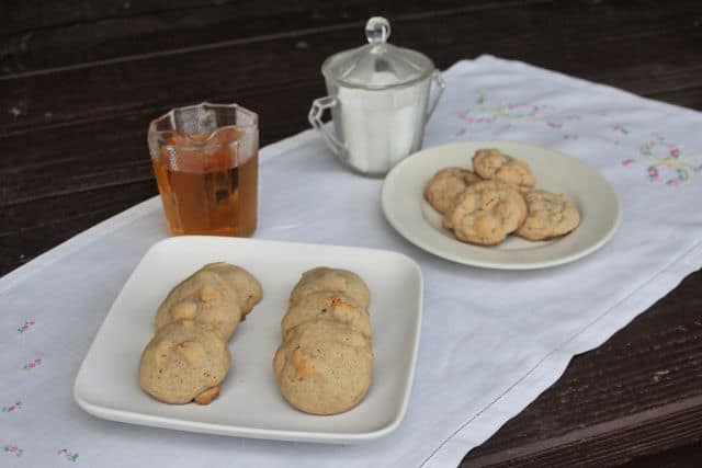 Dried apple cookies on plates with pitchers of maple syrup and sugar.