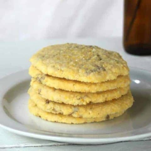 lilac cornmeal cookies on a plate.