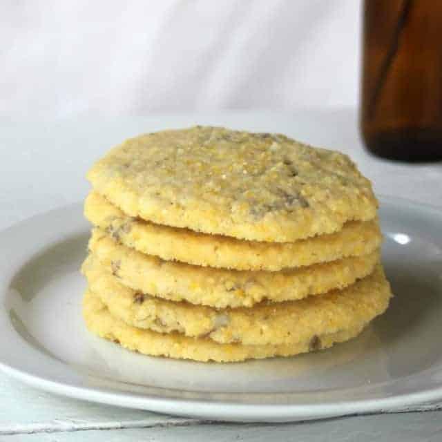 lilac cornmeal cookies on a plate.