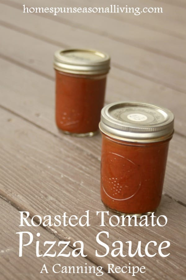 2 jars of roasted tomato pizza sauce on a table.