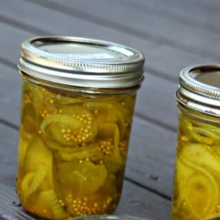 Jars of bread and butter pickles on a table