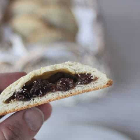 A rum raisin filled cookie cut in half to expose the filling.