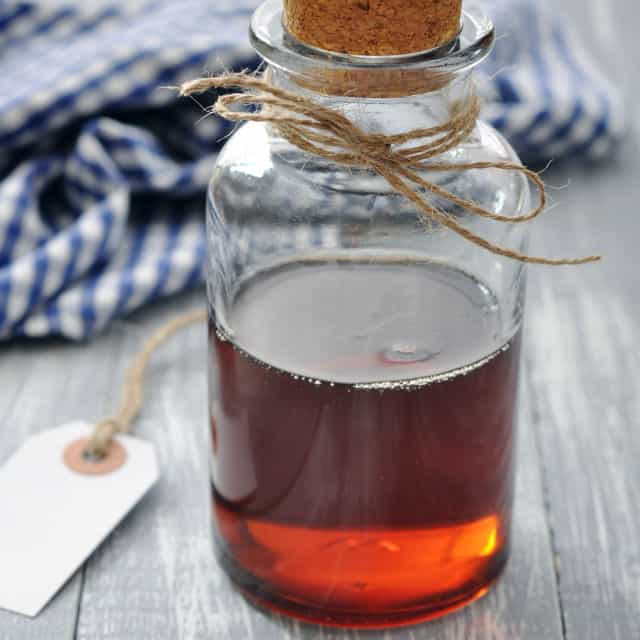 A glass bottle with maple syrup.