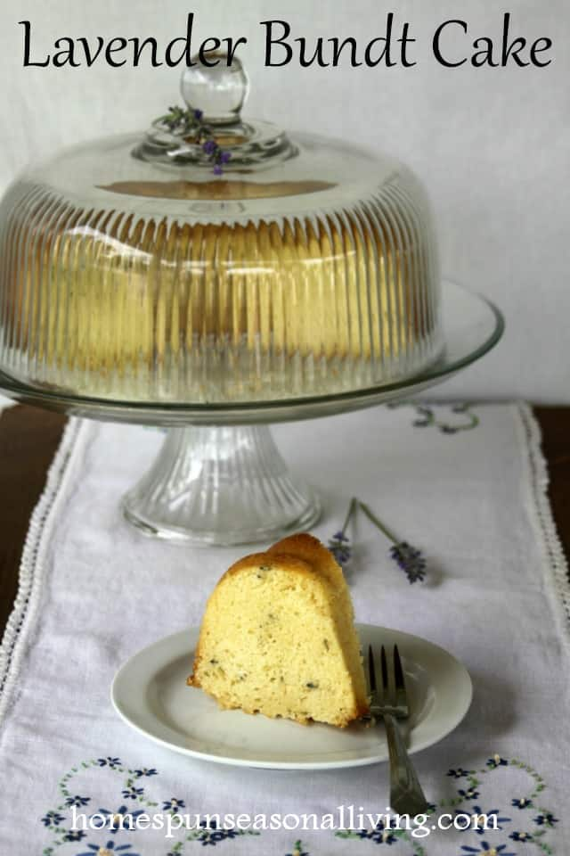 Lavender Bundt Cake on a cake plate with a slice.