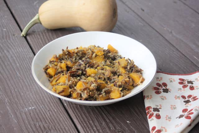 Winter squash and rice salad in a bowl with napkin.