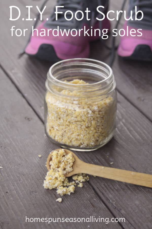 DIY foot scrub in a jar with wooden spoon.