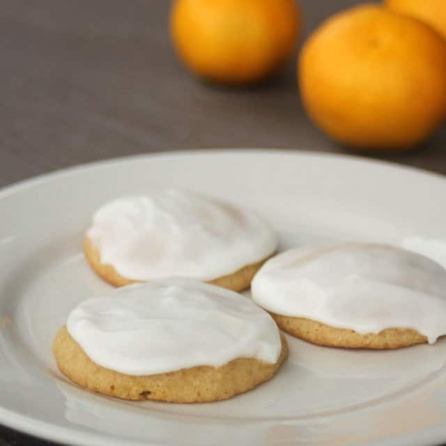 These frosted orange cookies are sure to please adults and kids alike with their soft and airy texture topped with a creamy icing.