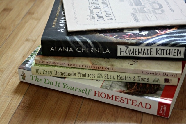 A stack of books on cooking and homesteading.