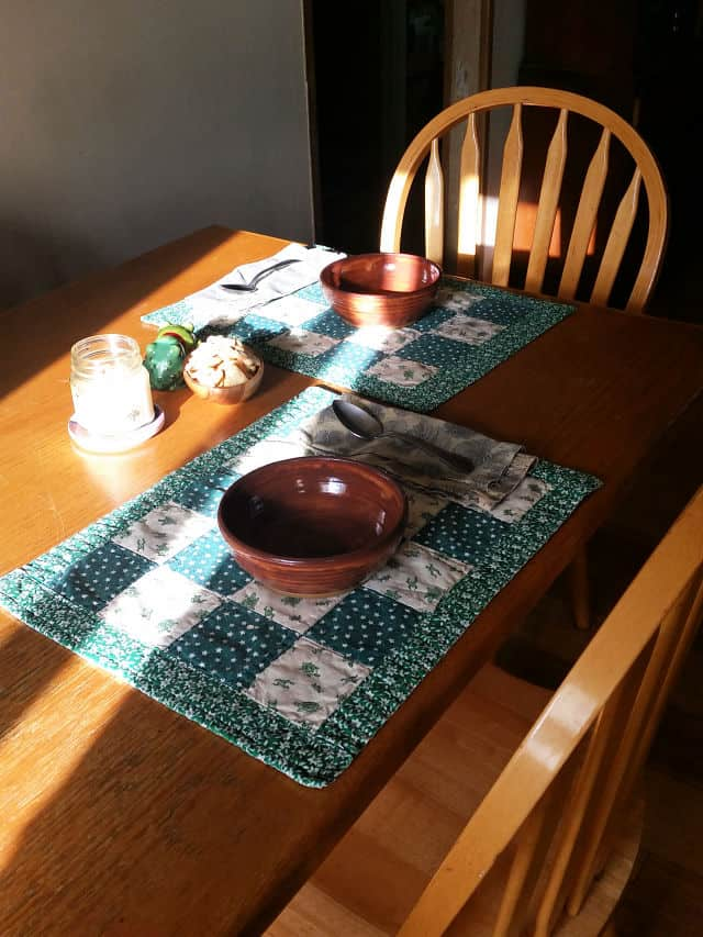 Table set for two with bowls on place mats.