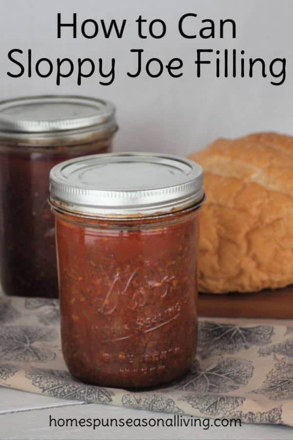 Jars of canned sloppy joe filling in front of a loaf of bread.
