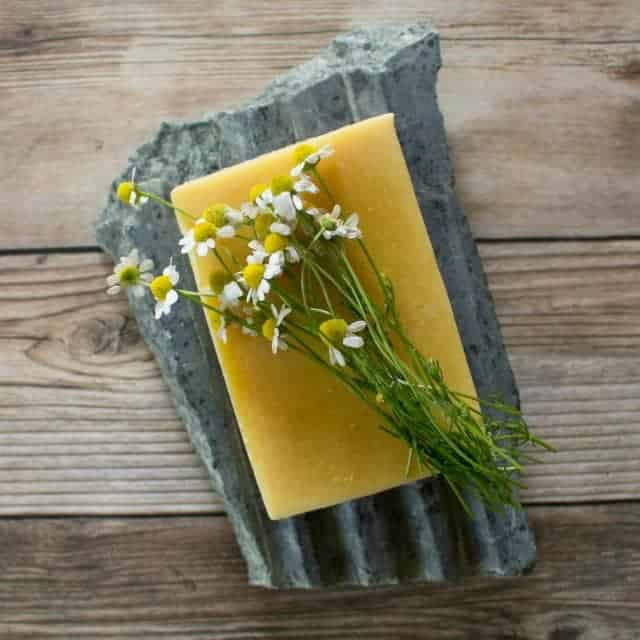 Use the garden to create skin nourishing and beautiful handmade chamomile carrot soap with this simple and natural recipe.
