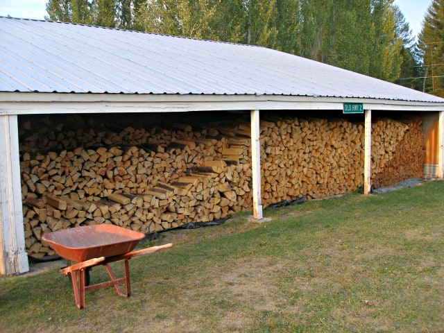 Fire wood stacked in a large shed.