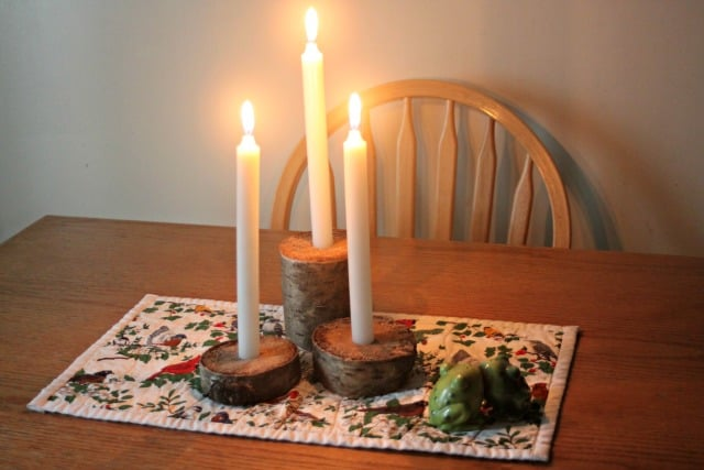 Make a natural table centerpiece with these easy DIY rustic candle holders. Use logs or branches and basic hand tools for a simple but elegant project.