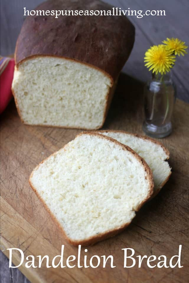 Homemade dandelion bread slices on a cutting board with loaf.