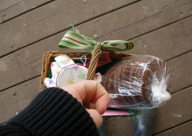 Gift basket with homemade cookies being hand delivered