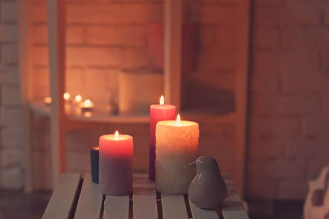 Burning candles on a wooden crate
