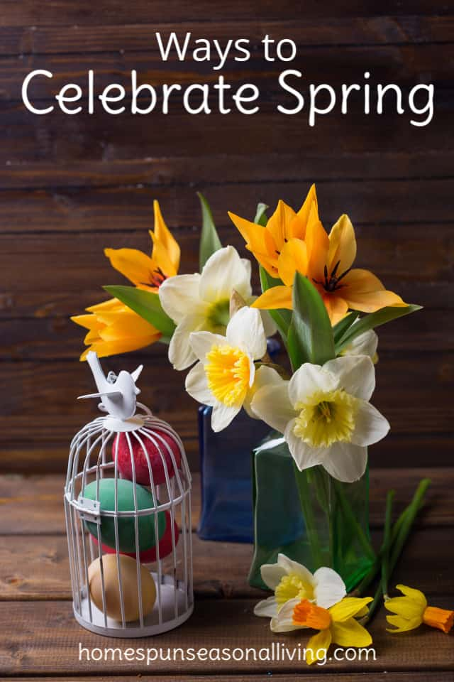 A bouquet of daffodils with colored easter eggs.