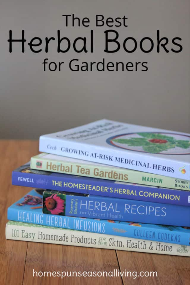 Stack of herbal books on a table.