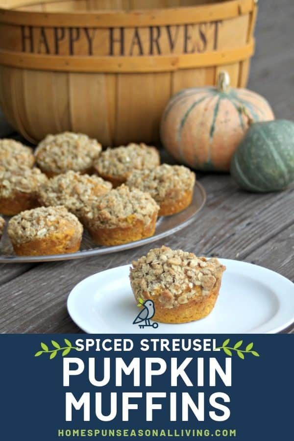 A pumpkin muffin with cardamom oat streusel on a plate in front of a platter of muffins surrounded by fresh winter squash and a basket..