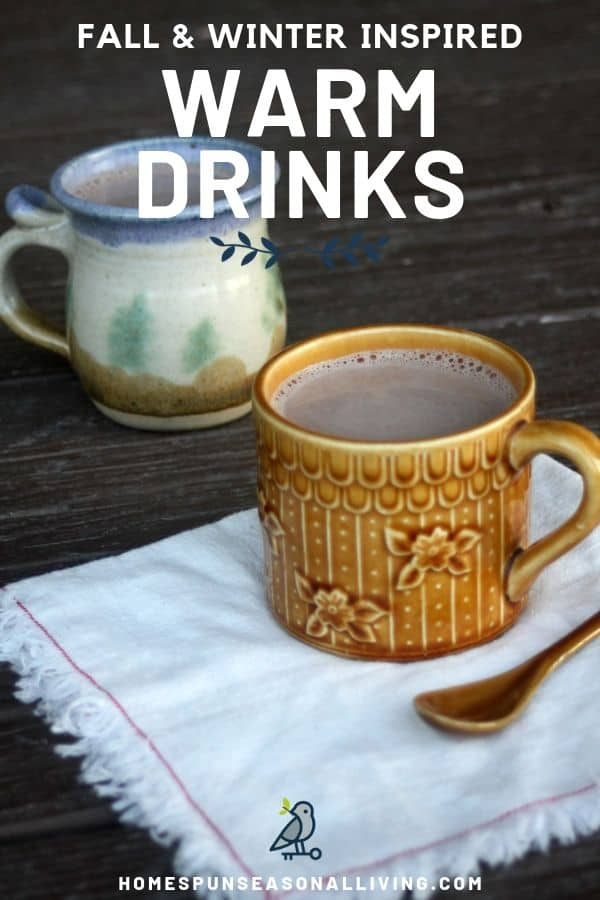 Mugs of warm drinks sitting with a napkin and spoon.