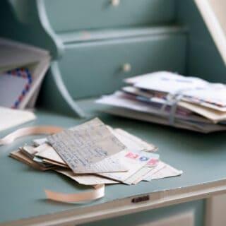 handwritten letters on a blue desk.