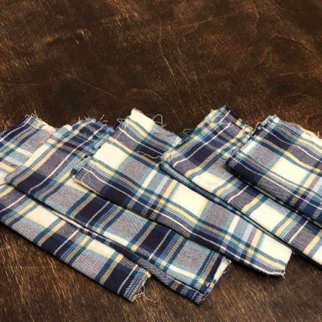 Flannel hankies in a stack on a table.