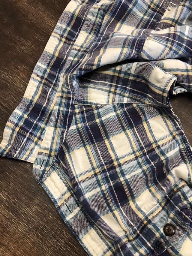 A flannel shirt piece being taken apart.
