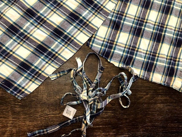 Pieces of a flannel shirt having the hems removed.