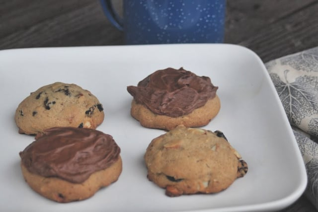 Hermit cookies with and without chocolate frosting on a plate.