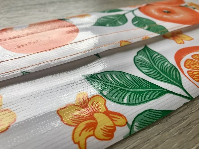 Top and bottom of oilcloth pieces held together with velcro
