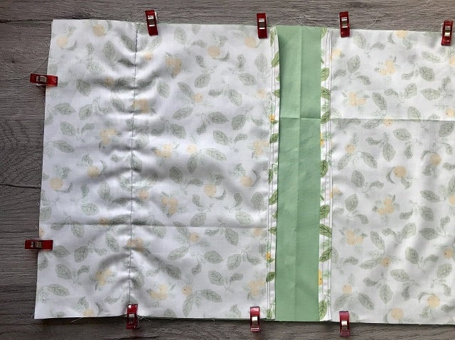 Top and Bottom fabric pieces clipped to back with right sides together