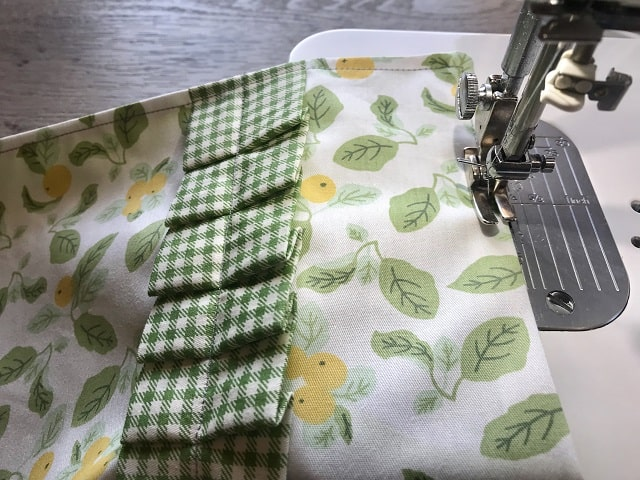 Sewing machine top stitching around clothespin bag