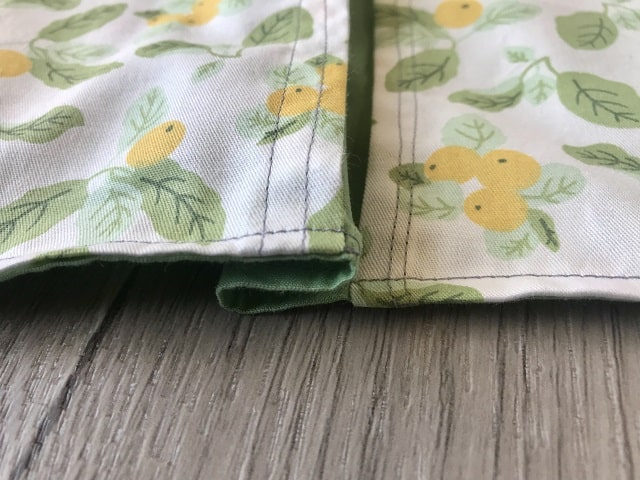 Back fabric gathered between top and bottom pieces