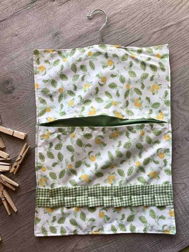 Completed DIY clothespin bag with lemons fabric and gingham ruffle