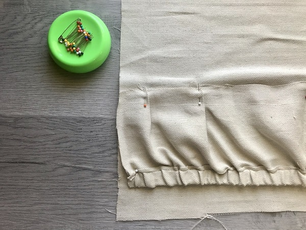 Top pocket pinned to apron based with pleats