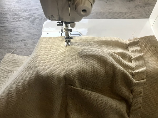 Sewing machine top stitching top pocket at pocket base