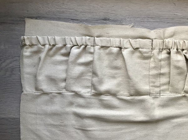 Top pocket with vertical stitches to form pockets