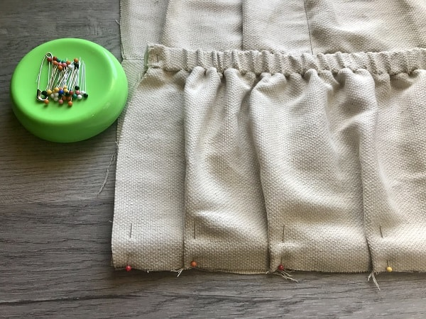 Pleats made at bottom of apron pocket and pinned in place with straight pins