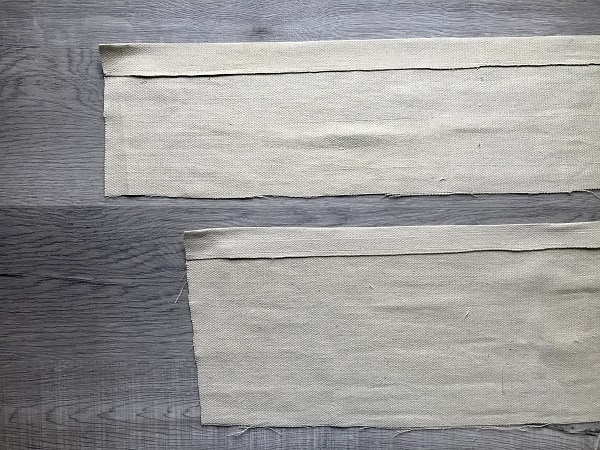 "Top and bottom pocket pieces with top edges flipped over 1.5"" and pressed"
