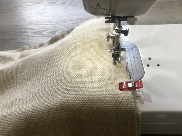 Sewing machine sewing around perimeter of apron with right sides together