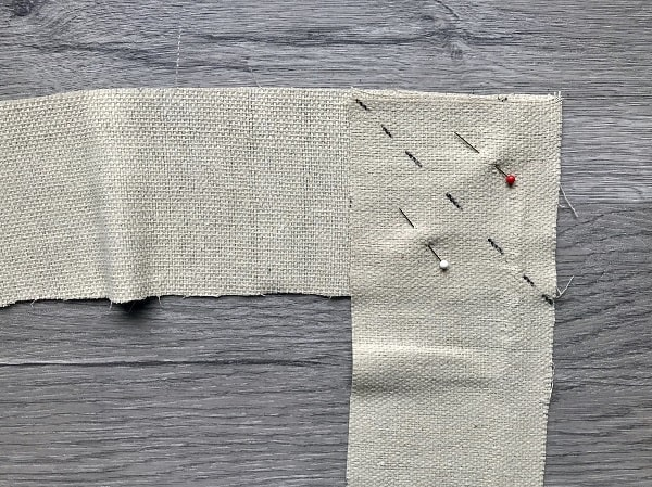 Diagonal line and pins marked to sew straps together