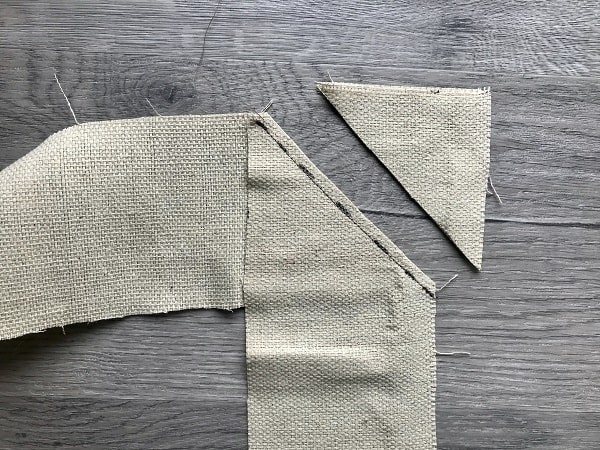 Drop cloth lengths sewn at diagonal with corner cut off