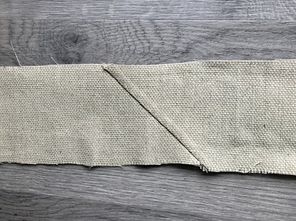 Seam of two lengths of drop cloth sewn together on a diagonal