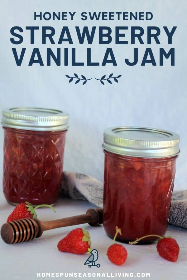 Two jars of strawberry jam on a table with fresh strawberries, a honey dipper, and cloth napkin with text overlay.