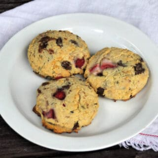 3 lavender strawberry cookies on a white plate.